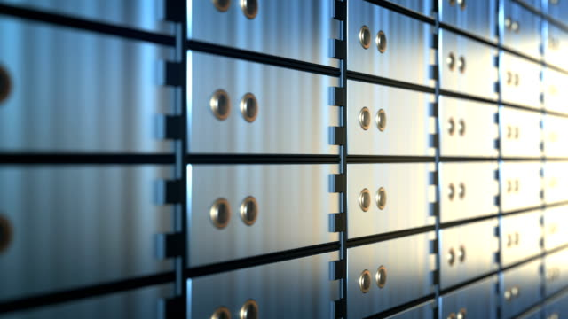 safe deposit boxes in a bank vault room, seamless loop - safes and vaults stock videos & royalty-free footage