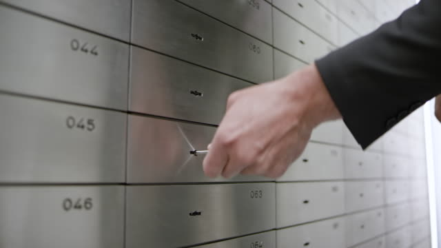 DS Safe deposit clerk granting access to the safe deposit box to a female customer opening it with her key video