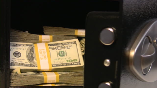 safe full of american dollars. money, cash, us currency, banking. - safes and vaults stock videos & royalty-free footage