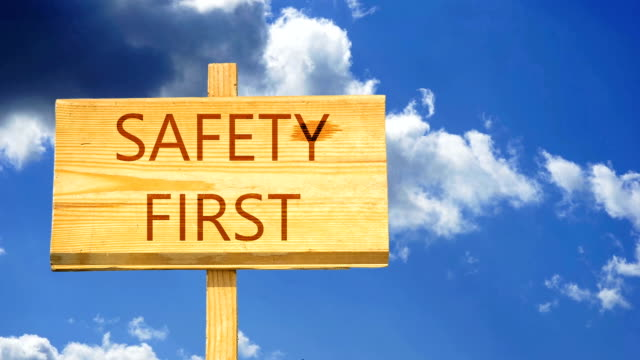 Safety first. Words on a wooden sign against time lapse clouds in the blue sky. Safety first. Words on a wooden sign against time lapse clouds in the blue sky. first occurrence stock videos & royalty-free footage