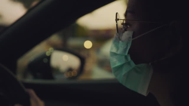 Safety practices during pandemic infection outbreak A young woman wearing protective mask cleaning hands with disinfecting wet wipes when she sitting in a car. white collar worker stock videos & royalty-free footage
