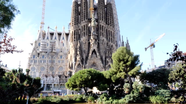 Sagrada de Familia by Antomio Gaudi. Spain Sagrada de Familia extrior by Antonio Gaudi. Famous tourist attraction in Barcelona, Spain. Neo gothic european architecture. Top to down panoramic view. Main temple or basilica or tower. No people. {{asset.href}} stock videos & royalty-free footage