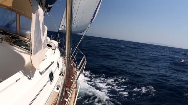Sail boat in open sea sailing with wind video