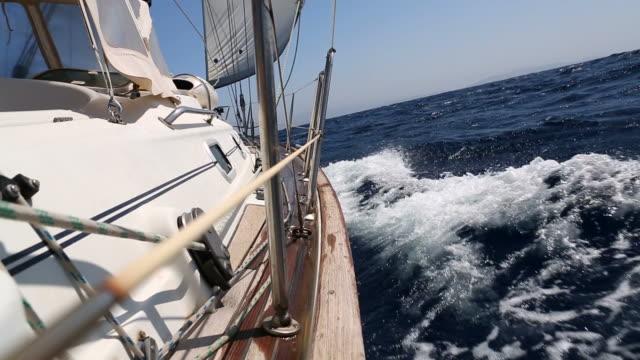 Sail boat sailing with wind at sea video