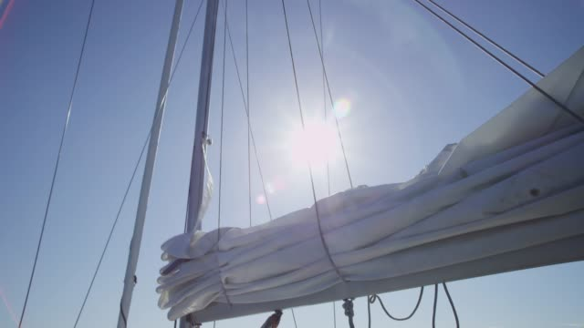 Sail on boat is raised. Sail on boat is raised. Shot on RED EPIC for high quality 4K, UHD, Ultra HD resolution. sail stock videos & royalty-free footage