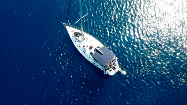 Sailboat at the open sea Sailboat at the open sea. Yachting, sailing, tourism, travel, nautic greek islands stock videos & royalty-free footage