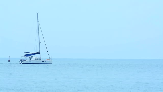 sailboat floating over the ocean sailboat floating over the ocean oceania stock videos & royalty-free footage