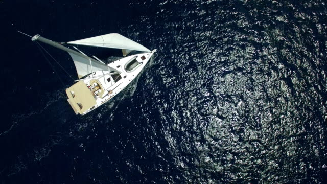 Sailboat from above, shot from drone Sailboat from above during sailing, shot from drone. mast sailing stock videos & royalty-free footage