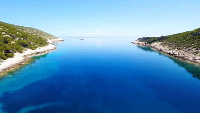 AERIAL Sailboat In A Beautiful Bay video