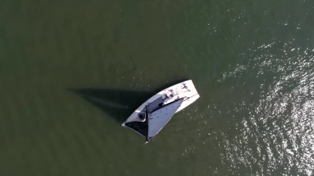Sailboat in the sea near the port. Footage. White sailboat in the sea video