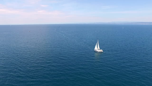 AERIAL Sailboat in the sea Aerial shot of a sailboat in the sea. Slovenia, Adriatic sea, Europe. recreational boat stock videos & royalty-free footage