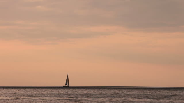 HD: Sailboat journey at sunset video