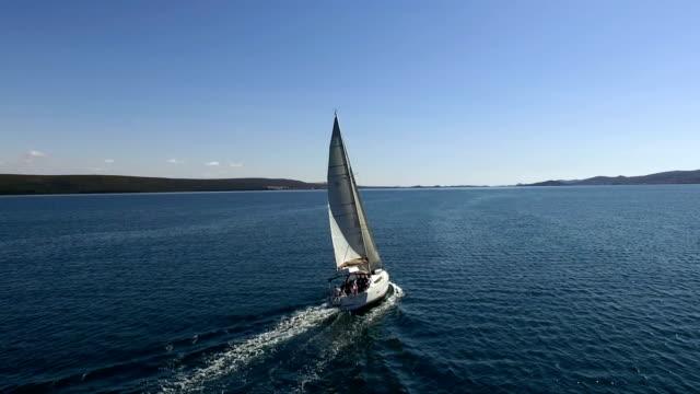 Sailboat sailing - rear aerial view video