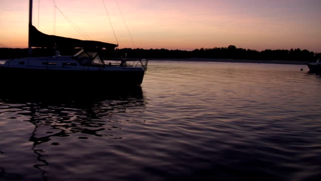 Sailboats in the harbor at sunset video