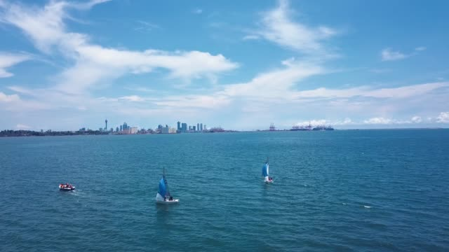 Sailboats in the ocean with Colombo in the background Sailboats in the ocean with Colombo in the background colombo stock videos & royalty-free footage