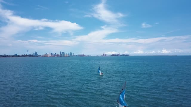 Sailboats in the ocean with Colombo in the background Sailboats in the ocean with Colombo in the background, in sunny Sri Lanka colombo stock videos & royalty-free footage