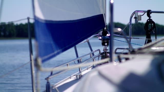 Sailing Boat details. Sun shining through sails, and rigging