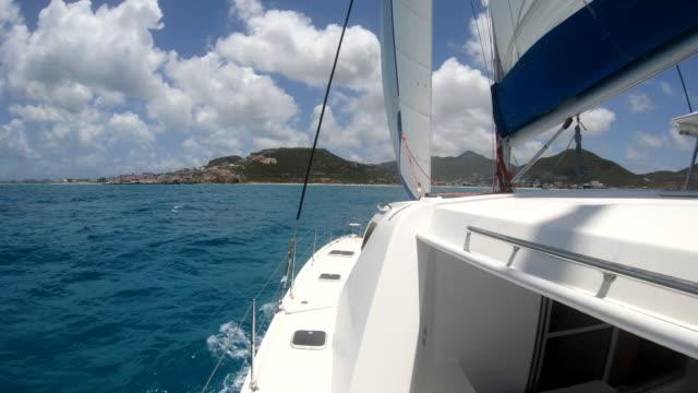 sailing on a 44 foot leopard catamaran in the carribbean sea st maarten dutch - saint martin caraibi video stock e b–roll