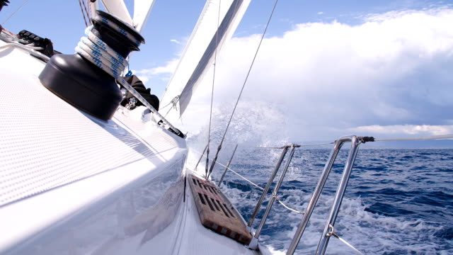 SLO MO Sailing On The Ocean HD1080p: SLOW MOTION shot of sea waves lapping against the sailboat while sailing on the ocean. regatta stock videos & royalty-free footage