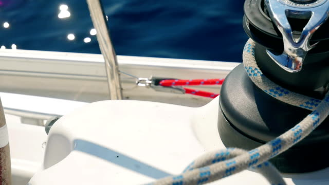 Sailing trip in Croatia Sailing boats ropes sliding through winches closeup shot in slow motion. crank mechanism stock videos & royalty-free footage