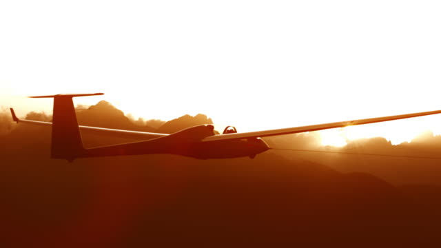 Sailplane high in the sky at sunset
