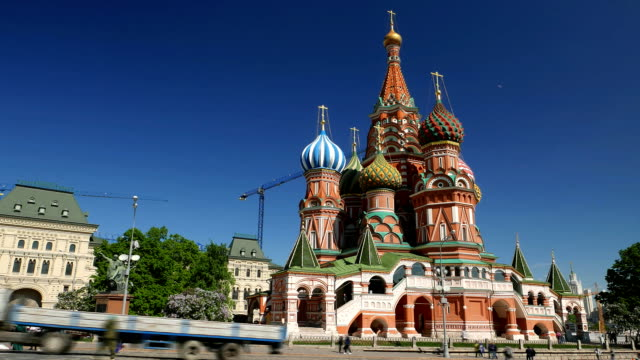 Saint Basil's Cathedral, tourists scurry around square, time lapse shot video