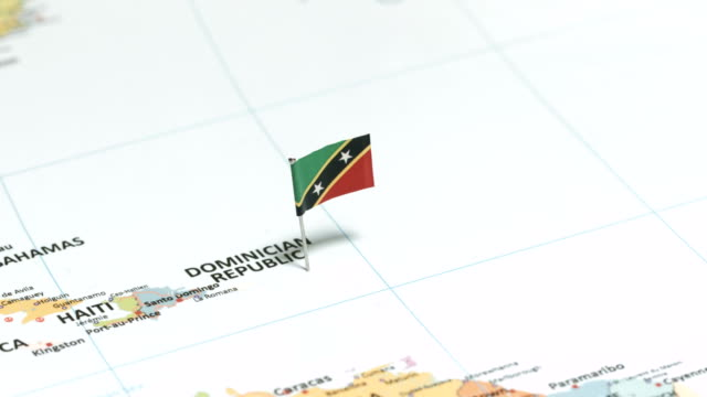 saint kitts and nevis with national flag - kingstown video stock e b–roll