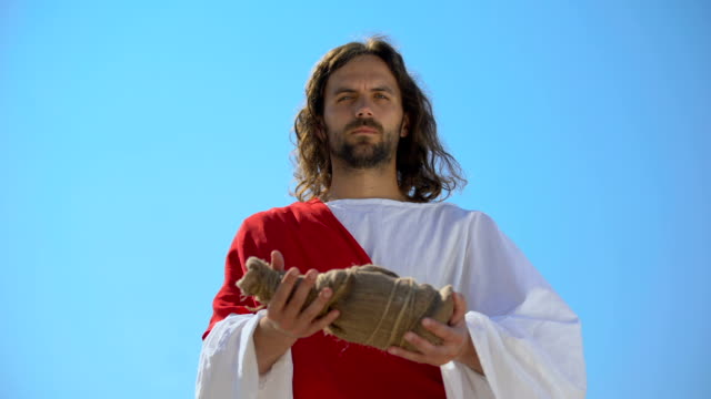 saint man offering bottle of water, biblical history to give drink to thirsty - communion stock videos and b-roll footage