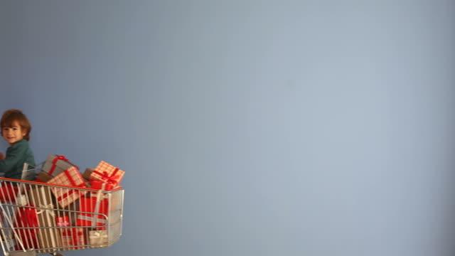 Saint Nicholas Pushing Shopping Cart Full Of Gift Boxes video