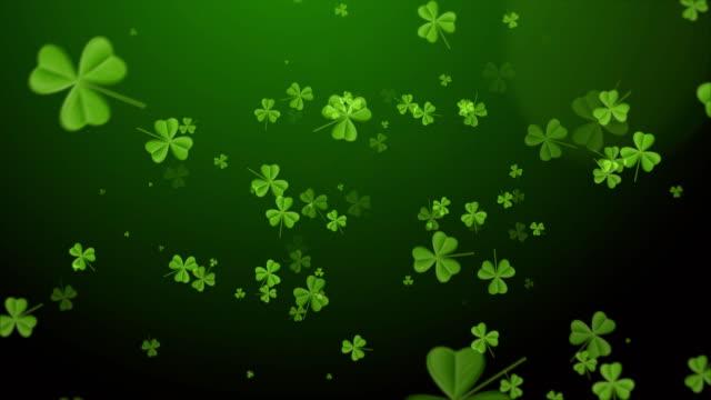 Saint Patrick's Day. Falling clover leaves over dark green background