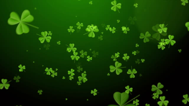 Saint Patrick's Day. Falling clover leaves over dark green background Saint Patrick's Day background. Falling clover leaves over dark green background shamrock stock videos & royalty-free footage