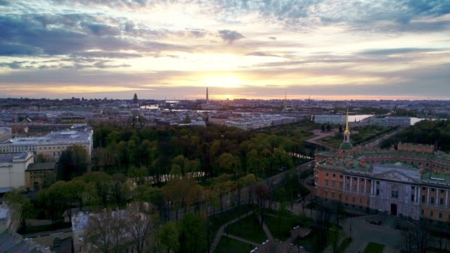 Saint Petersburg on a sunny spring morning. The sun rises over a city with colorful low houses in the Baroque style, highways filled with hurrying cars, parks and Grand palaces treedeo saint petersburg stock videos & royalty-free footage