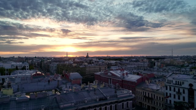 Saint Petersburg on a sunny spring morning. The sun rises over the city with its multicolored low houses in Baroque style, its highways filled with hurrying cars treedeo saint petersburg stock videos & royalty-free footage