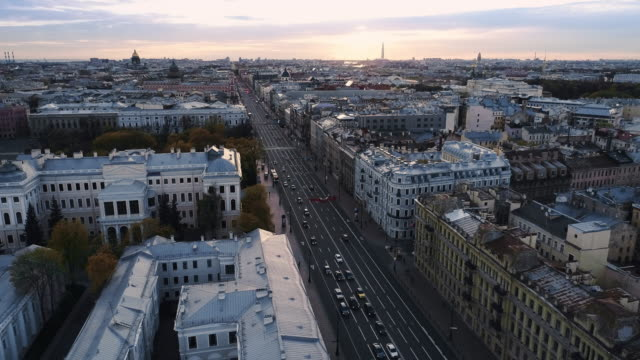 Saint Petersburg on a sunny spring morning. Urban landscape of multi-lane highways, house in the Baroque style, parks and pedestrian roads with people rushing somewhere treedeo saint petersburg stock videos & royalty-free footage
