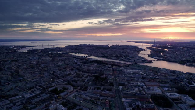 Saint Petersburg on a sunny spring morning. View at dawn from a drone on the sprawling city, river and bay in the distance treedeo saint petersburg stock videos & royalty-free footage