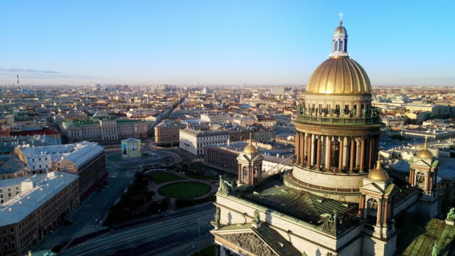 Saint Petrsburg on a sunny spring morning. View of the Saint Isaac's Cathedral. The church with a large central dome and four subsidiary domes. treedeo saint petersburg stock videos & royalty-free footage