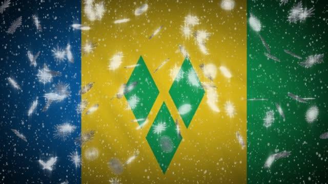bandiera di saint vincent e grenadine che cade in loop di neve, sfondo di capodanno e natale, ansa - kingstown video stock e b–roll