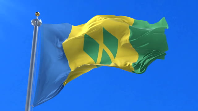 saint vincent and the grenadines flag waving at wind in slow, loop - kingstown video stock e b–roll
