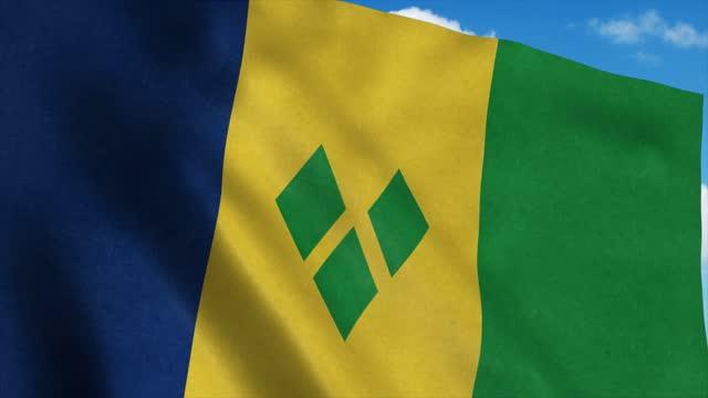 bandiera di saint vincent e grenadine che sventola nel vento, sfondo cielo blu. 4k - kingstown video stock e b–roll