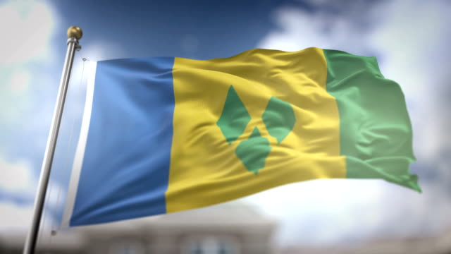 saint vincent and the grenadines flag waving slow motion 3d rendering blue sky background - seamless loop 4k - kingstown video stock e b–roll