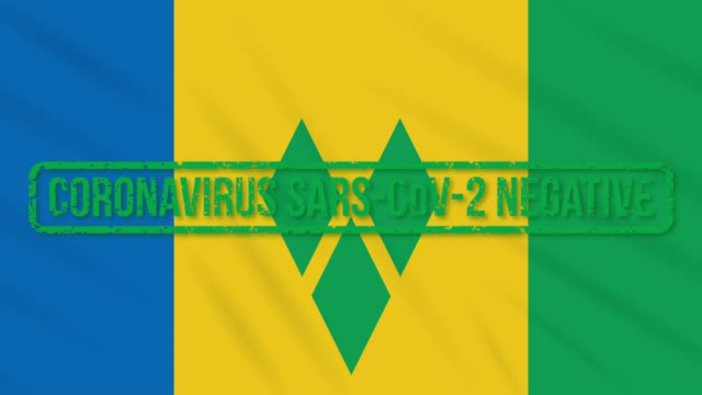 saint vincent and the grenadines flag with stamp freedom from coronavirus, loop - kingstown video stock e b–roll