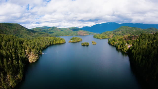 Sakinaw Lake BC Aerial Flying Through Channel Above Small Islets
