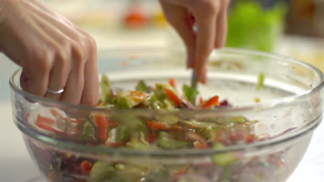 Salad mixing, slo mo video