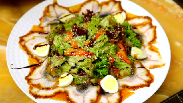 salad of eel with vegetables and quail eggs. - sesamo video stock e b–roll