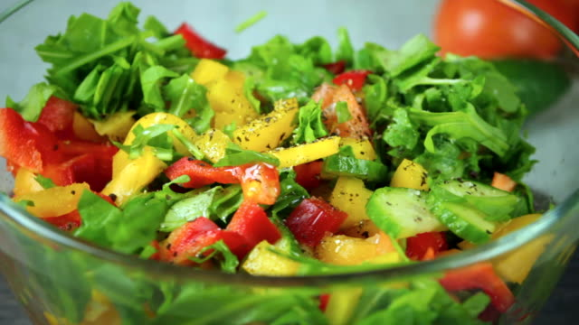 Salad of fresh vegetables rotate in a circle video