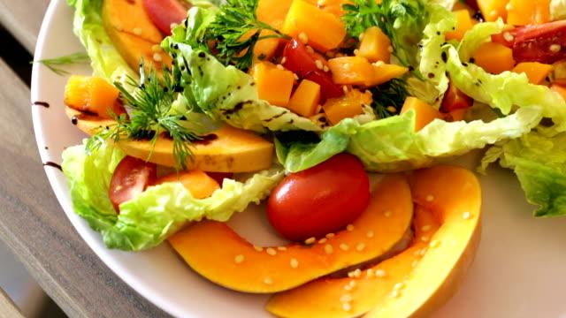 Salad with a baked pumpkin