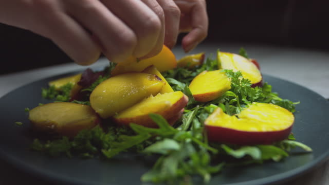salad with apricots and peaches, vegetarian salad, sprinkled with spices on a dark background