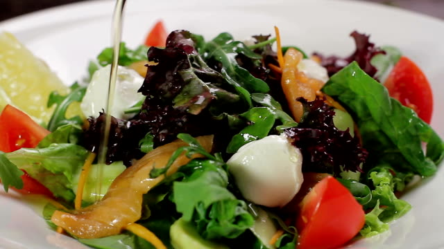Salad with salmon and vegetables. video