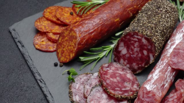 salami and chorizo sausage close up on stone serving board - meat stock videos and b-roll footage