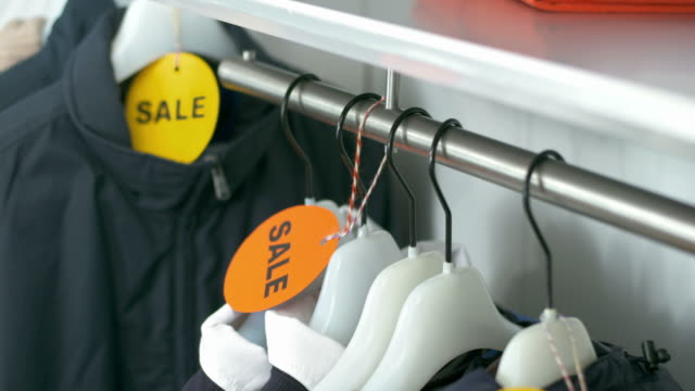 HD DOLLY: Sale Clothes Hanging On Hangers video